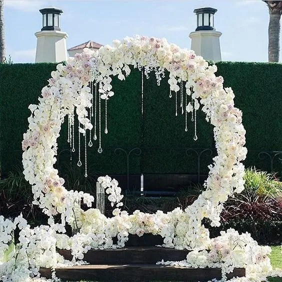 white and blush flower wreath with crystals hanging for a glam feel