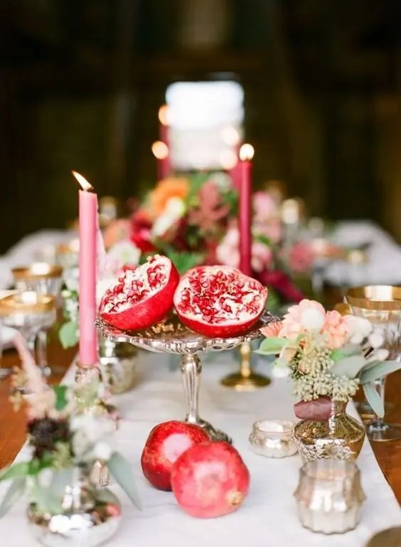a vintage silver bowl with a pomegranate for a fall or boho lux wedding