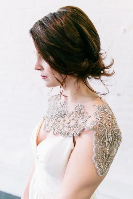 a bold shoulder jewelry piece with rhinestones and sequins for a deep V neckline dress