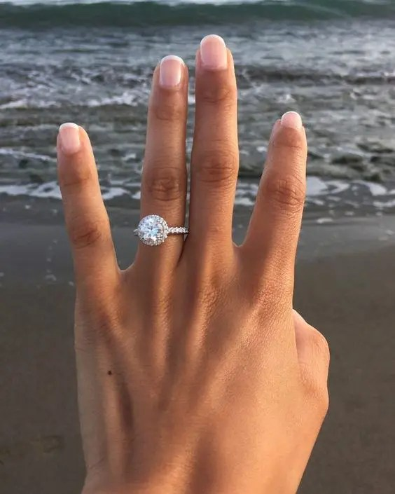 a classic round diamond white gold engagement ring with a halo will be loved by many girls