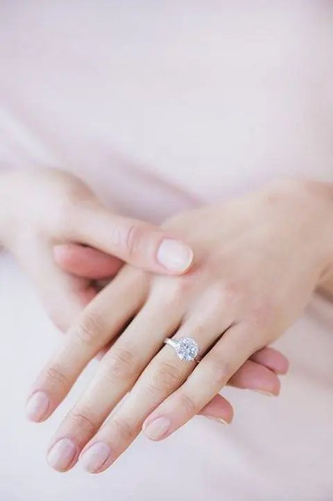 a delicate rose gold engagement ring with a round diamond for a slight romantic feel