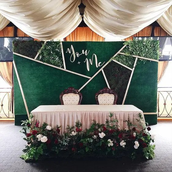 a modern geometric backdrop with fresh moss, foliage, calligraphy and matching fabric
