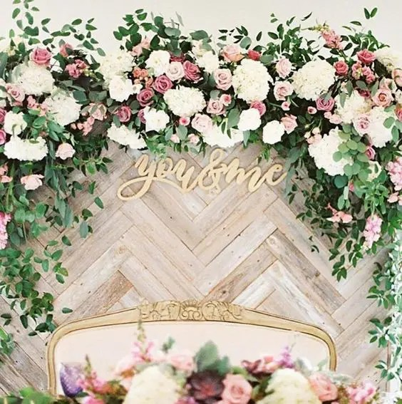 chevron-clad wooden backdrop with lush blooms and foliage for a chic look