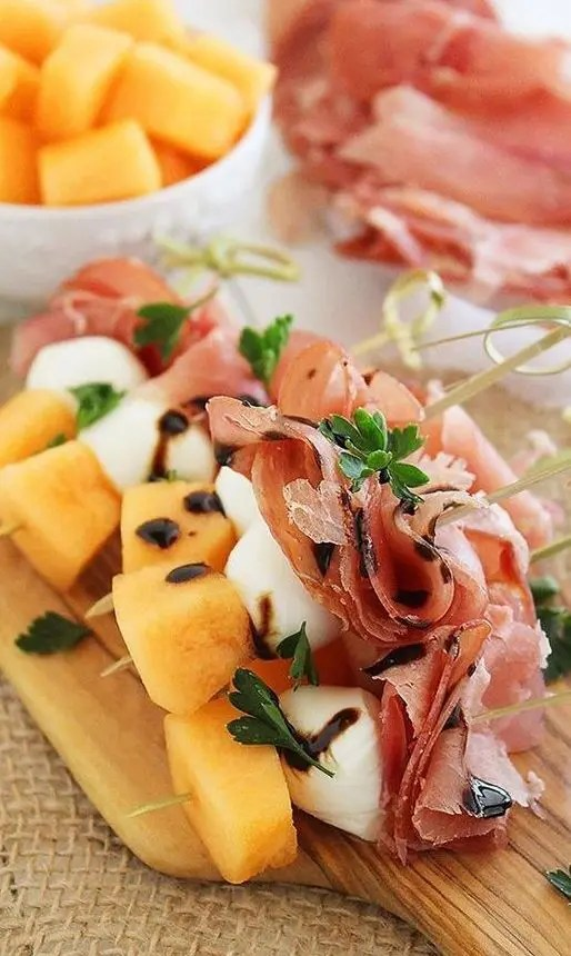 sweet and salty skewers with prosciutto, melon and creamy mozzarella drizzled with balsamic