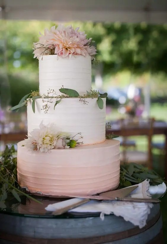 Picture Of an ombre buttercream blush wedding cake with blush blooms     Picture Of an ombre buttercream blush wedding cake with blush blooms and  eucalyptus on top