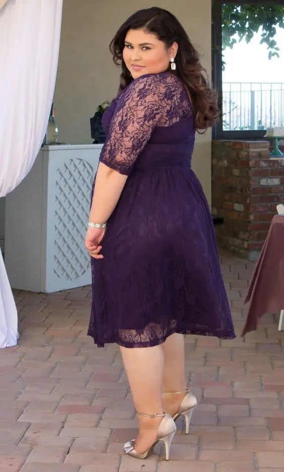 a plus size purple lace midi dress with half sleeves and an illusion neckline