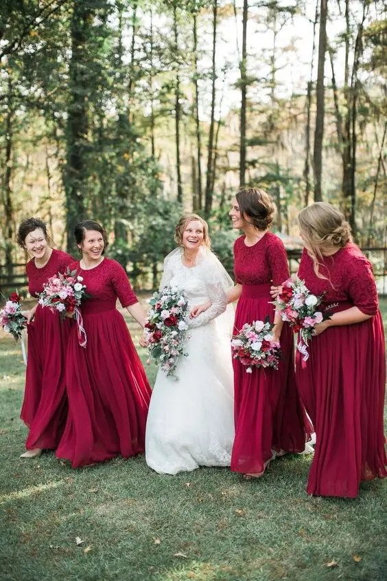 burgundy long sleeve maxi dresses with lace bodices and pleated skirts plus scoop necklines