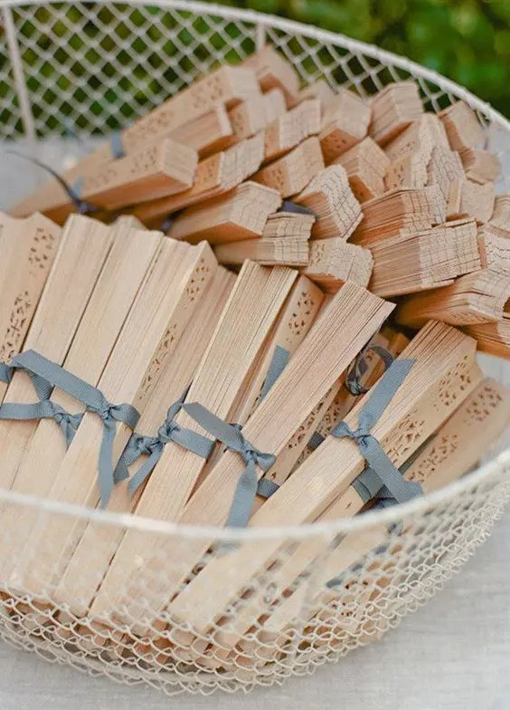 plywood fans are another comfy idea to take care of your guests on your big day, they will appreciate them