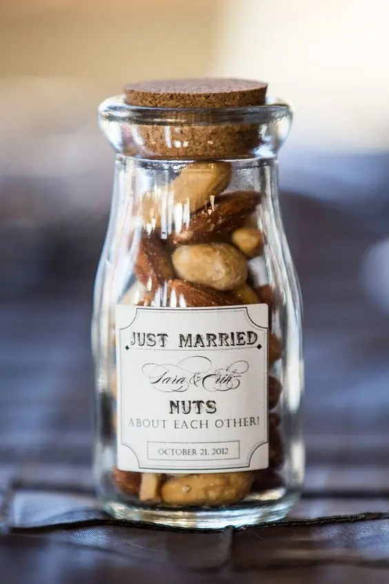 assorted nuts in a glass jar is always a great idea for most of weddings, from rustic to woodland ones