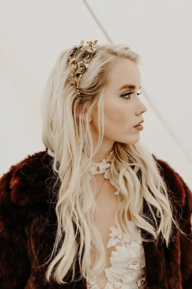 a catch floral bridal tiara that matches the faux fur coat for a boho bride