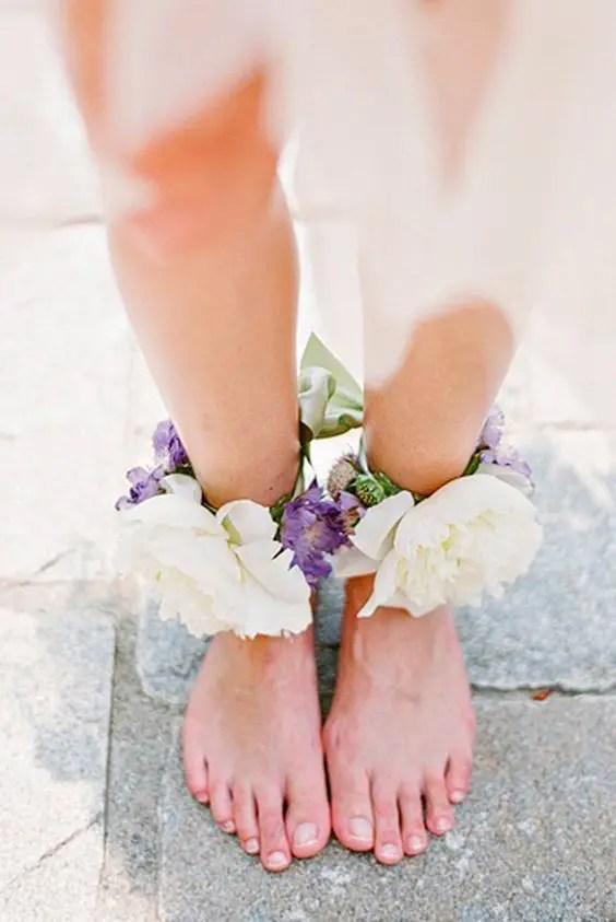 lush floral anklets with ivory and purple blooms will add a romantic feel and are ideal for a garden bride