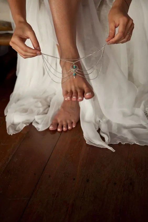 gypsy anklets with layeres of silver chain and some turquoise stones for a boho bride