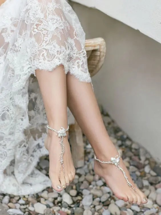 barefoot sandals with rhinestones and pearls for a delicate coastal bridal look