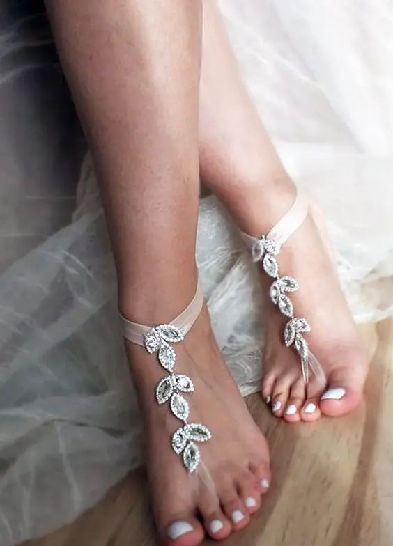 cute bejeweled bridal barefoot sandalds with a botanical motif for a garden bride