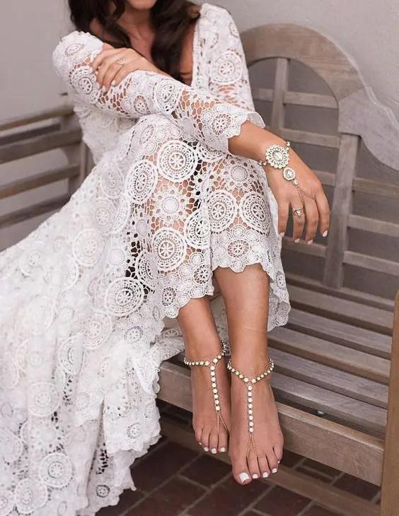 rhinestone barefoot sandals and a matching large rhinestone bracelet for a boho bride