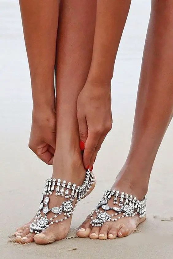 very chic gypsy beach barefoot sandals with lots of rhinestones and beads for a beach boho bride