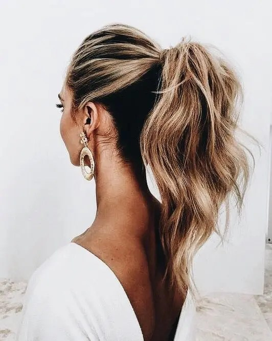 a ponytail with textural locks and a bump on top is a chic casual option