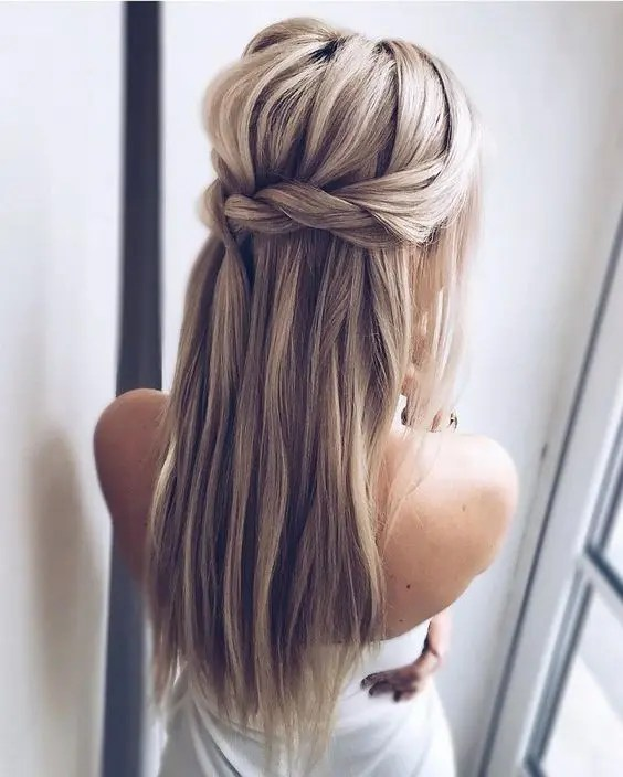 a Dutch braided half updo hairstyle with long hair down and a bump for those who don't want any waves