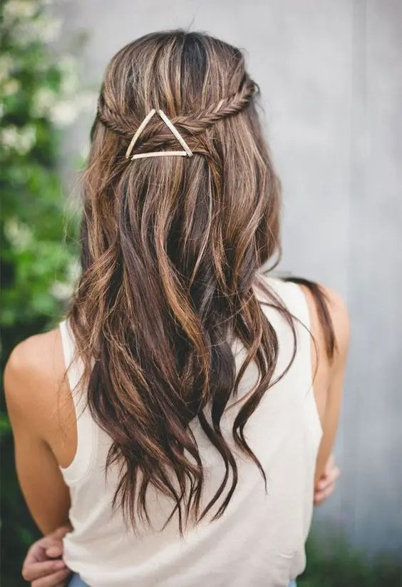 11a fishtail braided half updo with waves and an eye-catchy geometric hairpiece that adds a boho feel