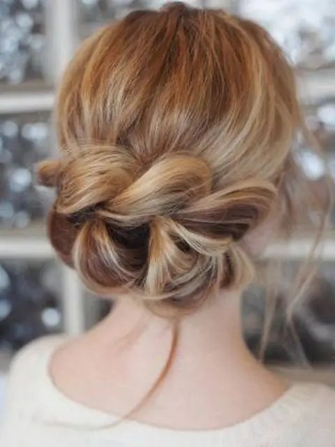 a low updo with a large braid instead of a chignon looks very eye-catchy and creative