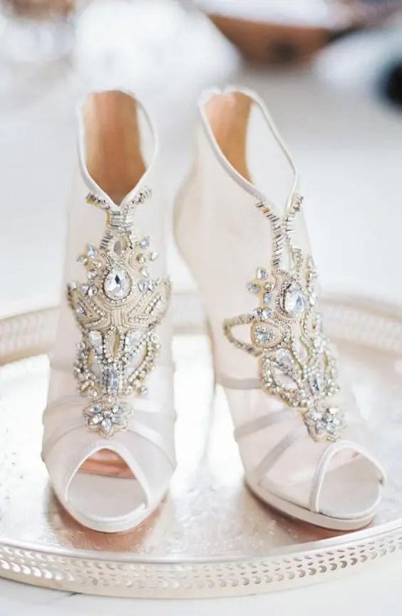 peep toe sheer bejeweled booties with heavy embellishments look very glam-like