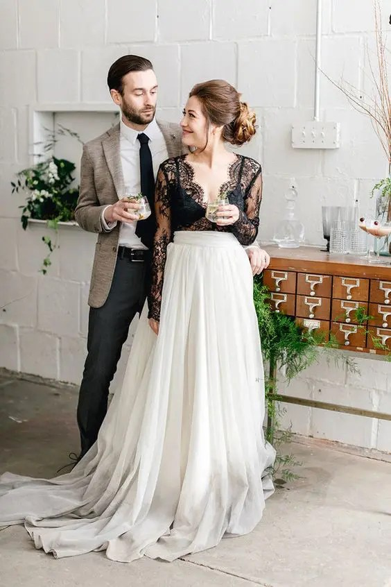 a black and white wedding separate with an ombre draped skirt and a black lace sheer top