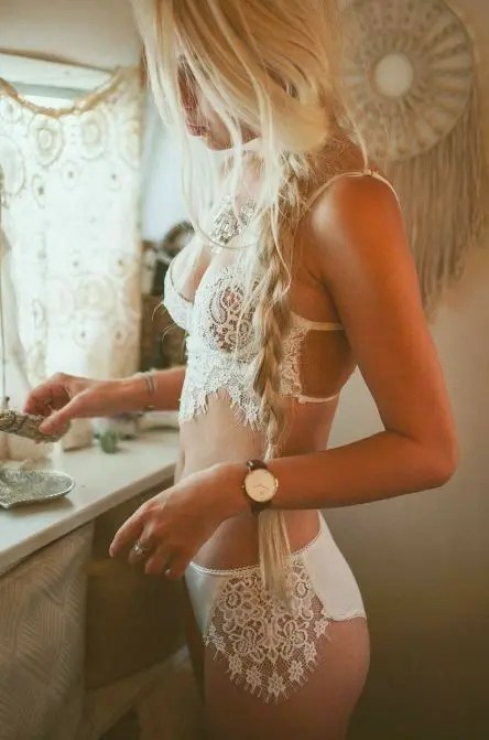 a cool boho-inspired lingerie set with much lace and straps and high waisted pants are perfect for boudoir shoot