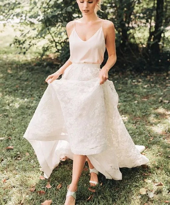 a chic bridal look with a creamy spaghetti strap top, a white lace maxi skirt and strappy sandals