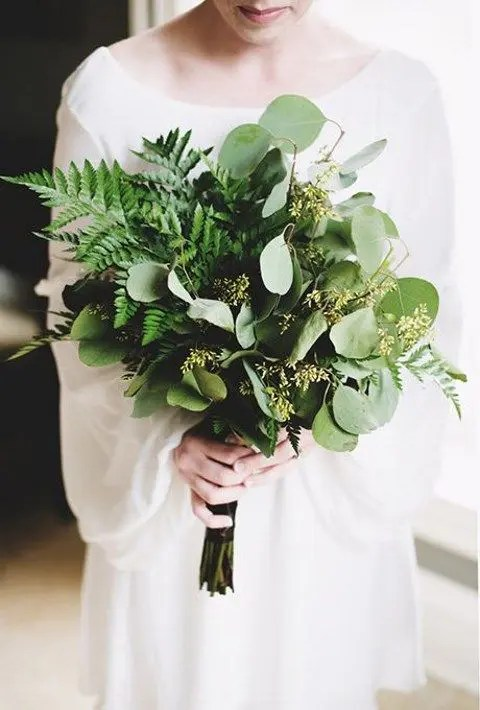 a stylish wedding bouquet with ferns and seeded eucalyptus looks very chic and very textural