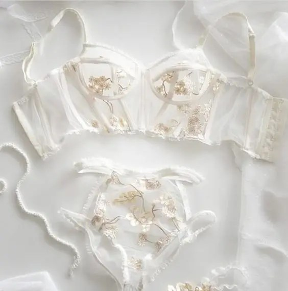 a heavenly sheer bridal lingerie set with gold floral lace appliques looks ethereal