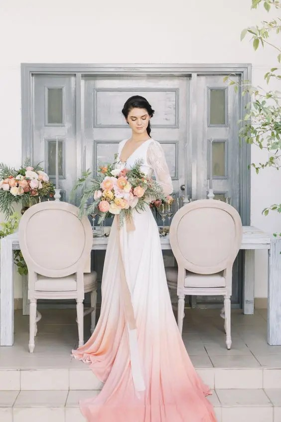 a bold bridal separate with a white lace crop top and a peach ombre A-line skirt with a train