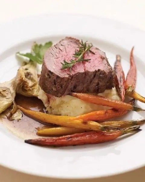 filet mignon with mashed potatoes, candied carrots and herbs is an ideal winter main course