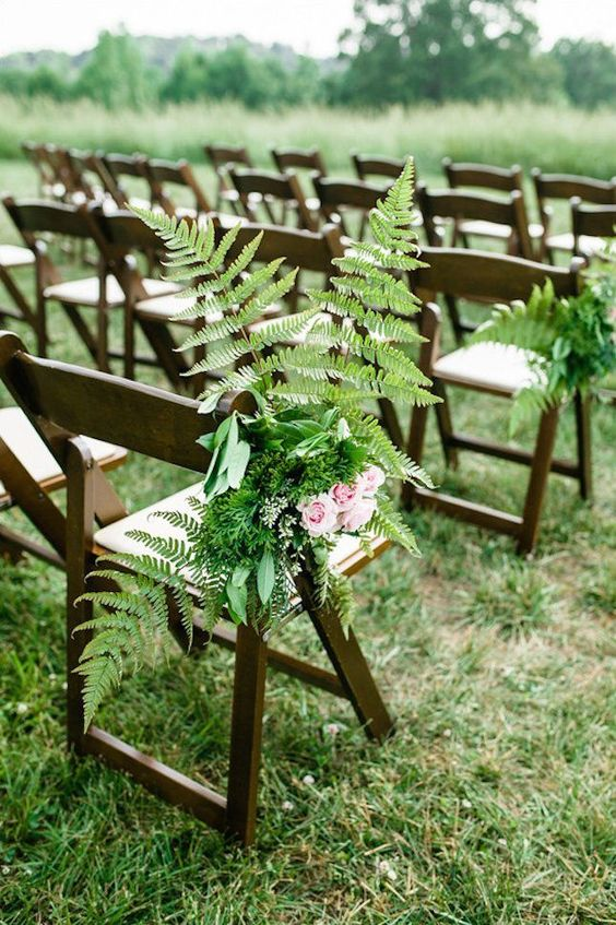 decorate chairs of the wedding aisle with ferns and pink roses to make the aisle naturally cool