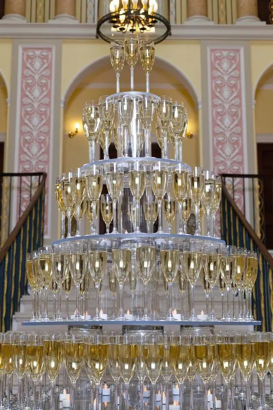 if you need a giant champagne tower but can't build it, look for a proper stand or stands for the glasses