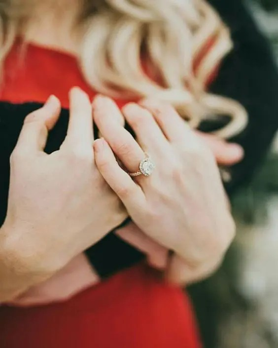 hug each other and show off your ring to create a feeling of love in the photo