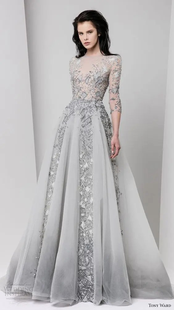 a grey silver A-line wedding gown with an illusion bodice and sleeves and a catchy skirt for an ice queen