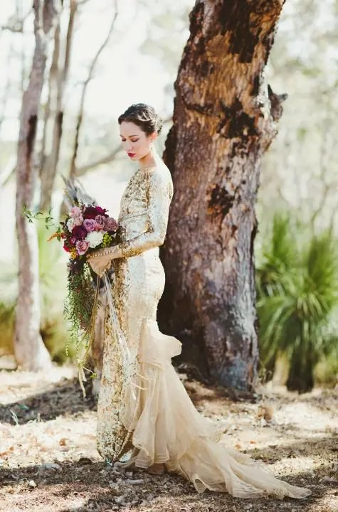 a sparkling gold sequin long sleeve dress with a matching tulle tail for a unique look