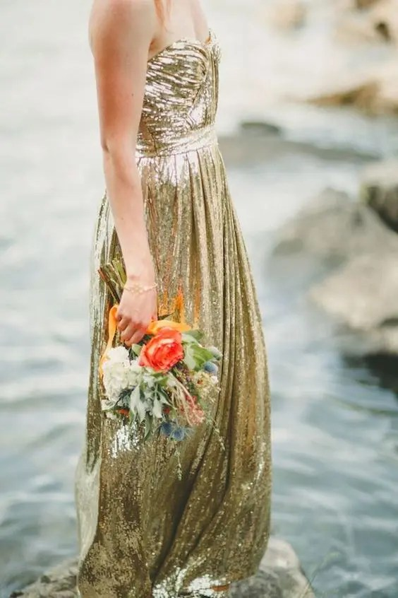 a strapless gold sequin A-line wedding dress is a timeless and sparkly idea to rock