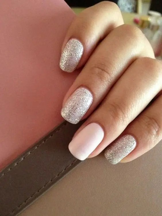 a silver glitter manicure and a blush accent nail for a cute and sweet girlish look