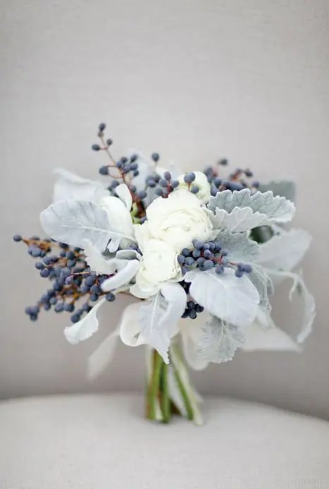 this bouquet seems to be frozen with white blooms, berries and pale miller