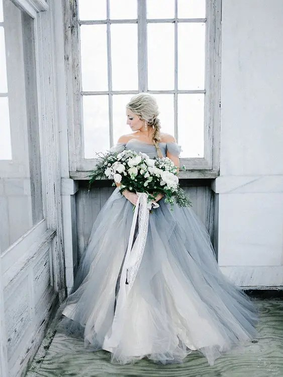 a grey off the shoulder princess-style gown with white layers for an ice queen look