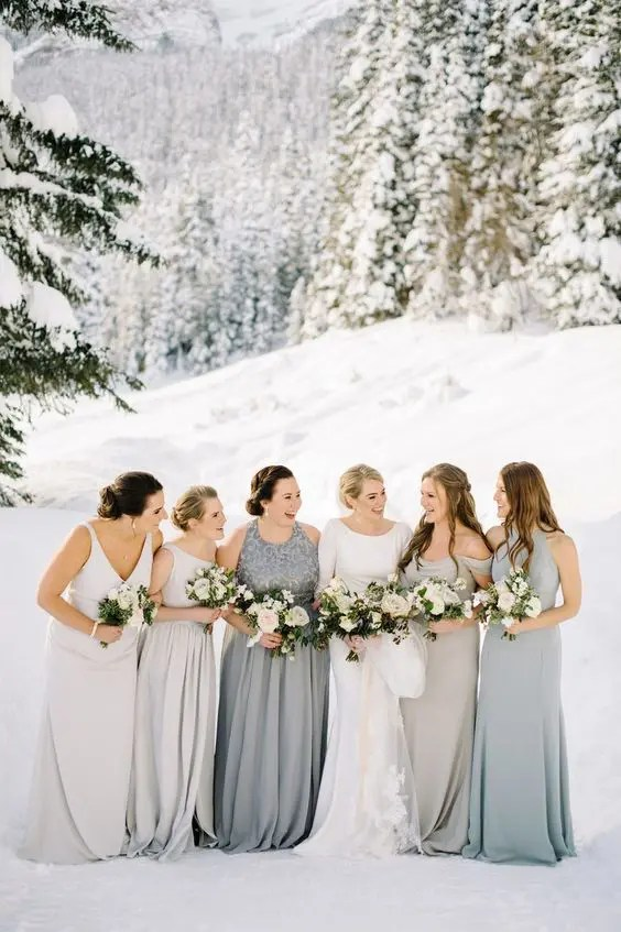 mismatching dove grey and silver grey bridesmaid gowns for an elegant and chic look