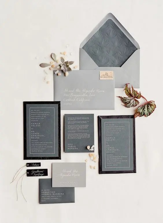 a grey winter wedding invitations suite with touches of black and letter pressing for a modern feel