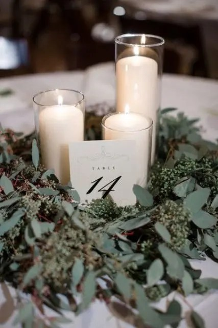 seeded eucalyptus and some candles will make up a cool centerpiece for any wedding, not only a winter one