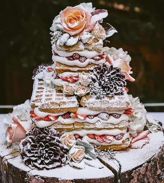 a waffle cake is a great alternative to a usual wedding cake, here it's topped with fresh blooms