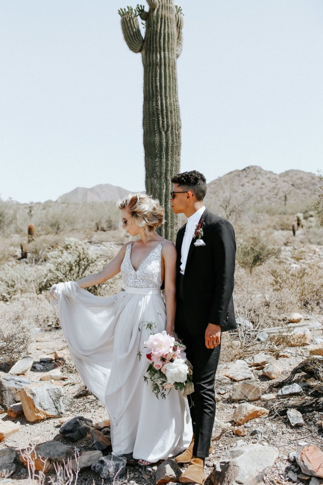 a romantic A-line wedding dress with a fully embellished bodice, a deep V-neckline and a flowy skirt