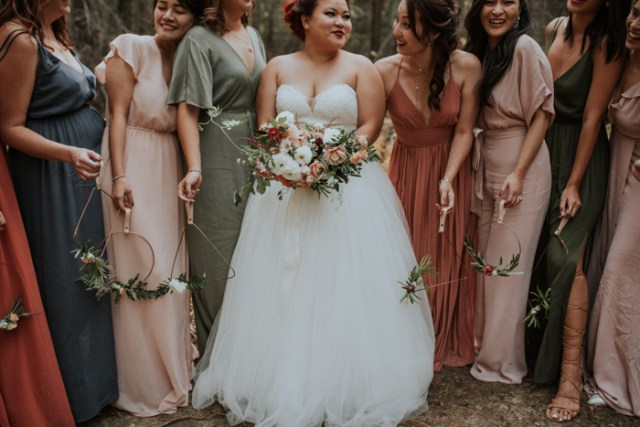 The bridesmaids were rocking mismatching earthy tone maxi gowns