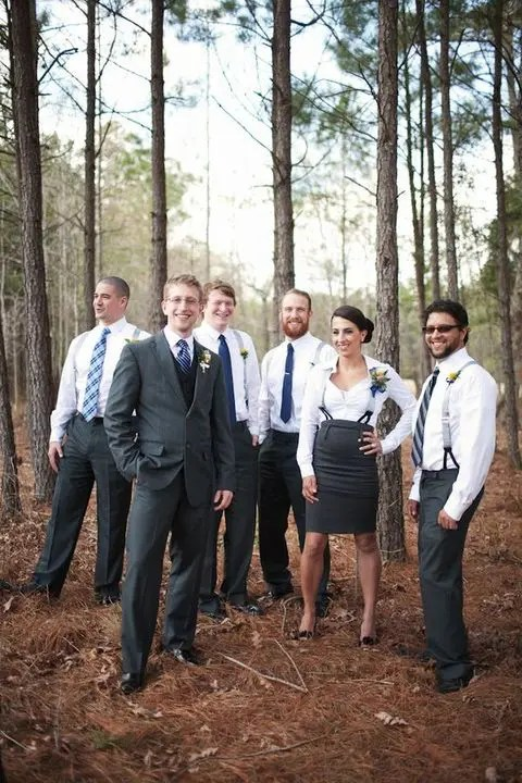 a mixed party wearing grey pants or a skirt, white shirts, grey suspenders and navy ties for guys