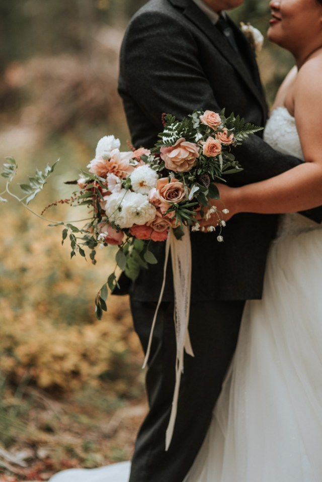 The wedding bouquet was very tender, with dusty pink and white blooms and lush greenery