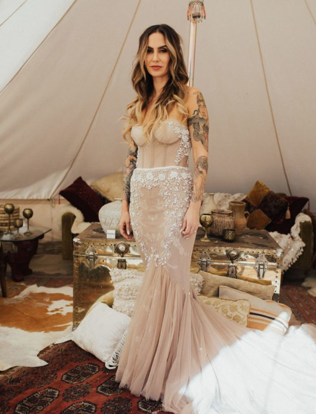 a strapless blush heavily embellished mermaid wedding dress with a train wows